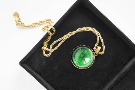 Vintage malachite locket pendant on gold chain in black jewel box