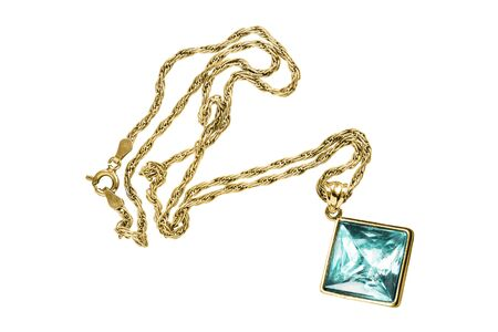 Gold necklace with large blue crystal pendant isolated over white Imagens