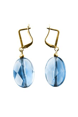 Pair of blue crystals gold earrings on white background