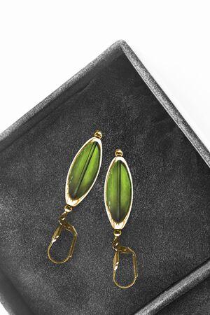 Vintage gold green earrings in black jewel box closeup