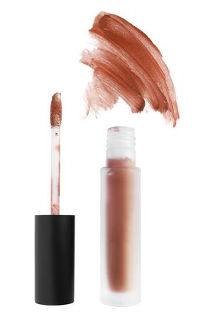 Orange lip gloss tube and color swatch on white background Stock Photo