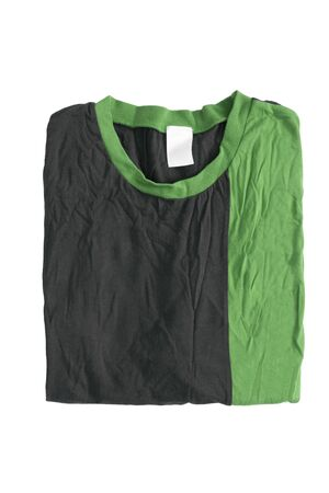 Folded black and green t-shirt on white background