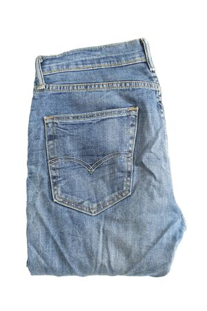 Folded blue jeans pants on white background 版權商用圖片