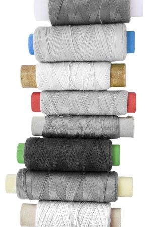 Group of black and white spools of threads on white background