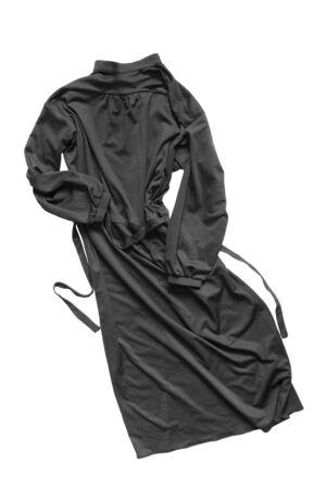 Black silk long crumpled dress on white background