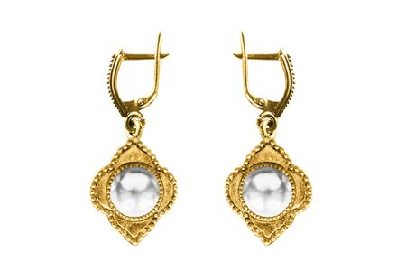 Vintage old gold pearl earrings isolated over white Stock Photo