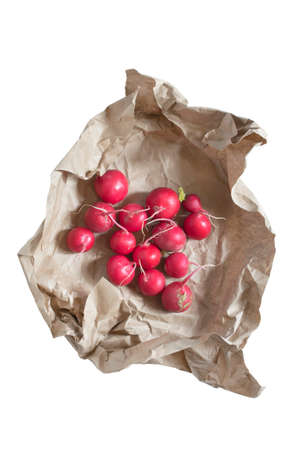 Some raw red radish wrapped in craft paper isolated over white Reklamní fotografie