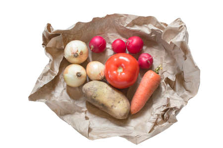 Some raw farm vegetagles wrapped in craft paper isolated over white
