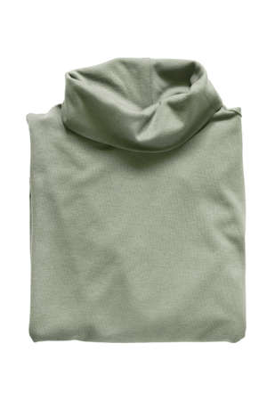 Folded green khaki turtleneck pullover isolated over white