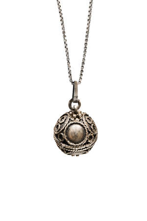 Vintage bronze ball pendant on a chain isolated over white Banque d'images