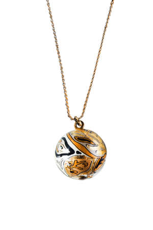 Golden pendant ball on a chain isolated over white