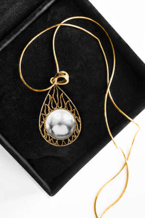 Elegant carved gold pendant whith large white pearl in black jewel box