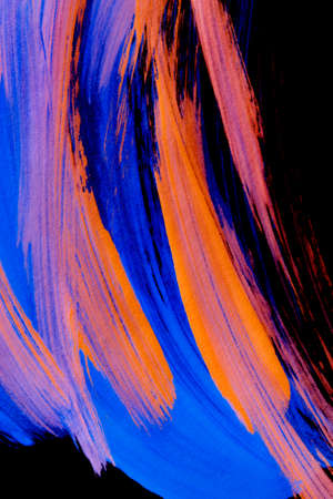 Abstract blue and orange drawings on black background closeup 版權商用圖片