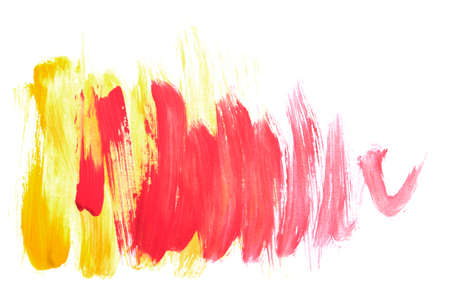 Yellow and red paint brush strokes isolated over white 版權商用圖片