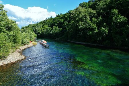 immortality: Green Earth and the Chitose River Summer clouds and Lake shikotsu Stock Photo