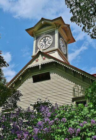 odori: Lilac clock tower Stock Photo