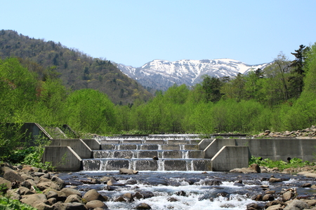 ridgeline: A mountain and river of the spring remaining snow