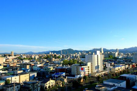 View of mountain ranges from the city of Sapporo