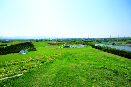 Sapporo in spring, Scenery of Moerenuma Park, Play mountain, outdoor stage, pyramid of glass, and mot facilities with tria ngle If are seen