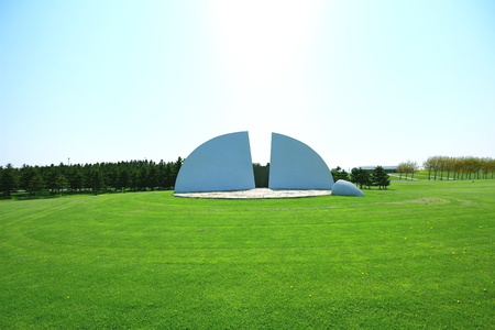 Sapporo in spring, Scenery of Moerenuma Park, Play mountain, outdoor stage, pyramid of glass, and mot facilities with triangle If are seen