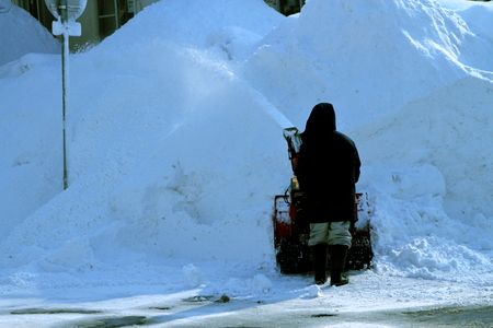 People in the city snow removing at the intersection of snow for passers-by Stock Photo