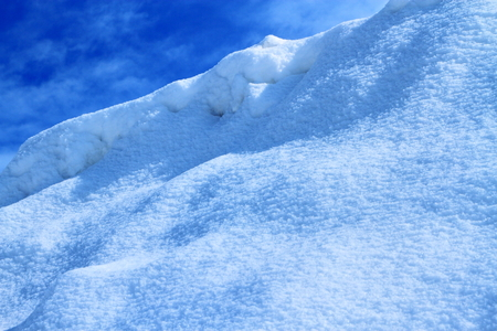 Snow crystal and snowflakes background is a blue and white world shining under the sun.