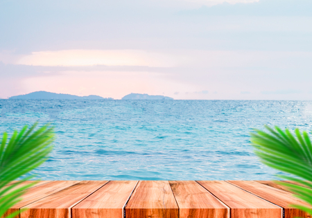 Top of wood table with blurred sea and palm tree background,Concept Summer, Beach, Sea, Relax. Stock Photo