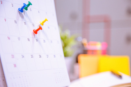 Calendar Event Planner is busy.calendar,clock to set timetable organize schedule,planning for business meeting or travel planning concept.
