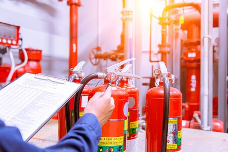 Engineer checking Industrial fire control system,Fire Alarm controller, Fire notifier, Anti fire.System ready In the event of a fire.