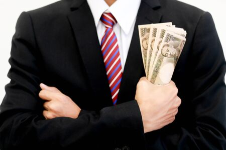 Businessman with money in hand, yen ,investment, success and profitable business concepts.