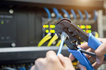 Male hand preparing a Lan Cable.