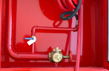 Watercourse fire extinguisher red. 免版税图像 - 149435199