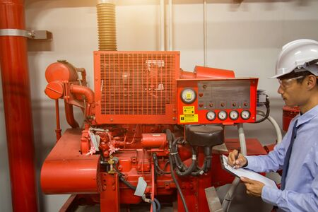 diesel generator for fire control system red piping and valve. Imagens