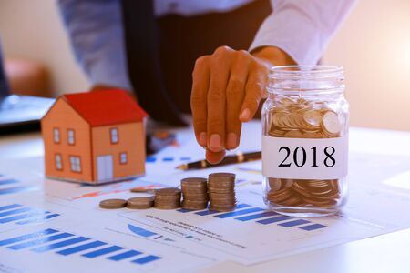 Businessmen collect money to buy a home in the future 2018.