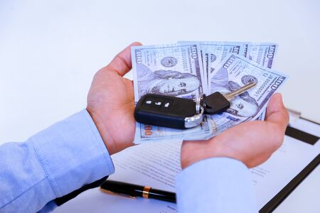 Successful businessman offering a car key with contract.Rental agreement for a car with contract.Car Insurance.