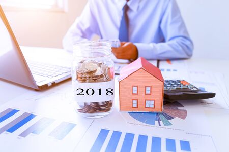 Men collect money to buy a home in the future 2018.