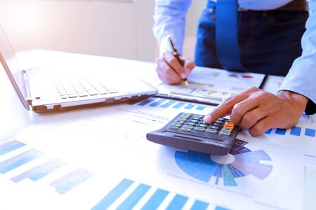 Businessman analyzing investment charts with Accounting.