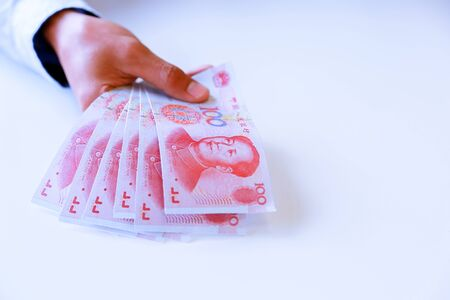 Businessman with cash yuan - business concept,tablet and finance,investment,save. 免版税图像