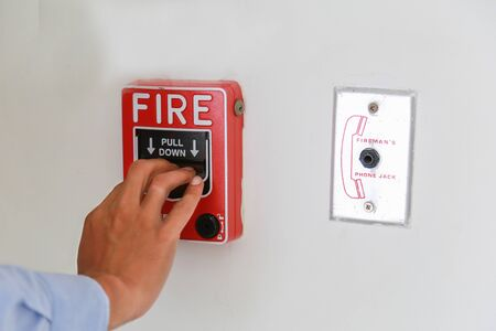 fire alarm box on cement wall for warning and security system.