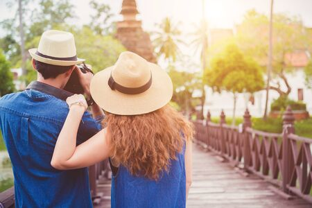 Young travelers are enjoying archaeological attractions. And enjoy digital photography.