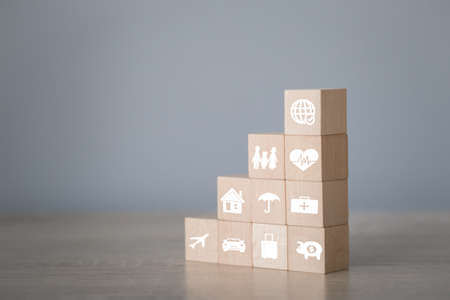 Arranging wood block stacking with icon and insurance: car,