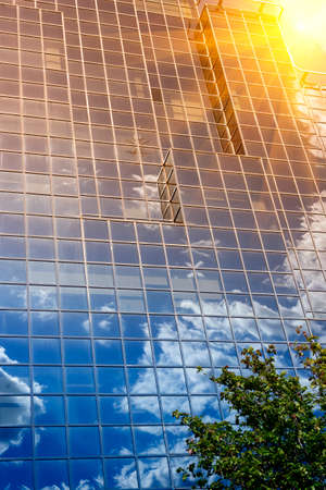 abstract london: reflecting sky and sun in glass of office building  Stock Photo