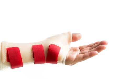 splint: Left woman hand with palm up and wrist and thumb splint
