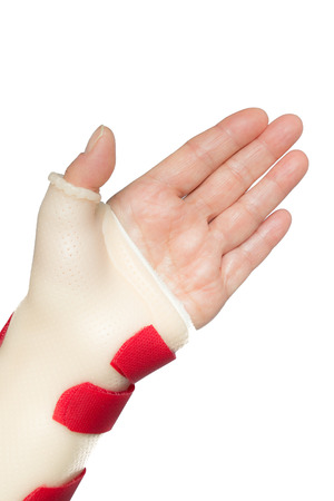 splint: Palm of woman left hand with wrist and thumb splint Stock Photo