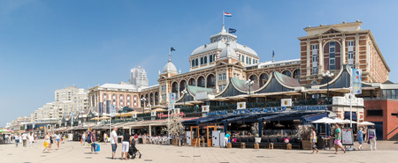scheveningen: SCHEVENINGEN, THE HAGUE, NETHERLANDS - JULY 3, 2015: Kurhaus hotel and waterfront promenade of Scheveningen in The Hague, Netherlands