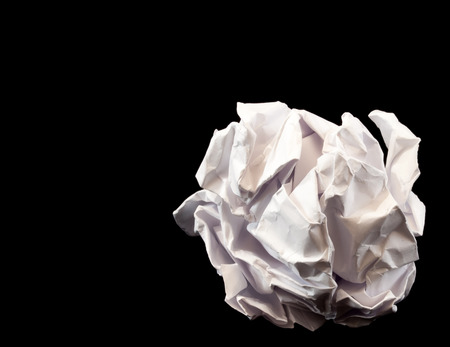 creasy: Close-up of crumpled paper ball on black background
