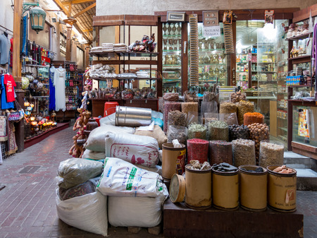 suq: DUBAI, UNITED ARAB EMIRATES - JAN 26, 2014: Shops in the spice souk in the Deira district of Dubai, United Arab Emirates Editorial