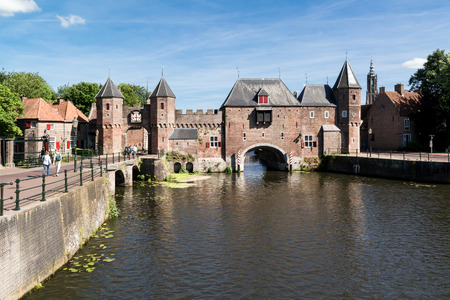 eem: Medieval fortress city wall gate Koppelpoort and Eem River in the city of Amersfoort - tourist destination near Amsterdam, Netherlands