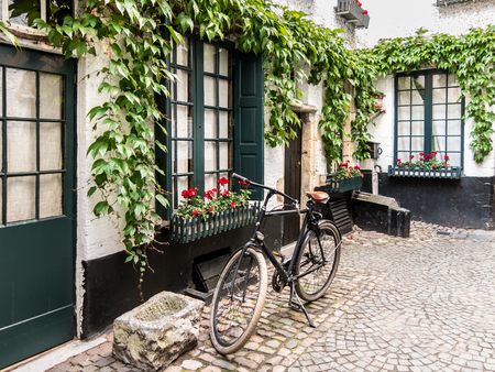medieval: Small medieval alley called Vlaeykensgang in the city centre of Antwerp in Flanders, Belgium Stock Photo