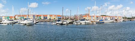 waterfront property: HELLEVOETSLUIS, NETHERLANDS - AUG 25, 2015: Houses and yachts in the harbour of Hellevoetsluis, Netherlands